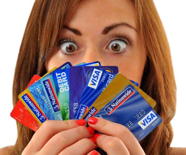 BRDJ1X Credit cards, woman holding lots of credit and debit cards. Image shot 09/2010. Exact date unknown.
